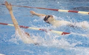 Carman-Ainsworth's Tyler Pangerl (top) holds a slight edge over Swartz Creek's Evan Eldred in the backstroke during the Dec. 4 meet at Creek. Pangerl won the event by less than a second, and the Cavaliers won the meet, 94-92.