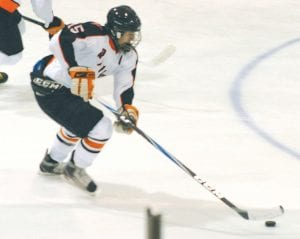 Flushing's Mickey Montpas drives the puck through the neutral zone during Saturday's win over Lapeer.