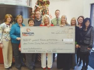 Financial Plus Federal Credit Union staff present a check to Kathy Rometty of Goodwill Industries (center).