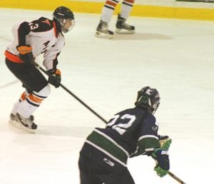 Flushing's Mickey Montpas drives the puck into the offensive zone on Dec. 15 against Lapeer at Iceland Arena.