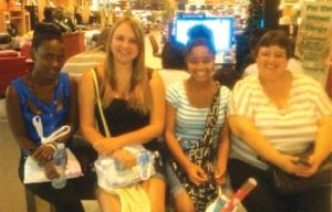 Rani Richardson (second from right) with Magda, (far right) representative for the Youth for Understanding international educational exchange program; with Paula, Magda's exchange student from Germany (second from left) and Patricia, Magda's domestic helper.