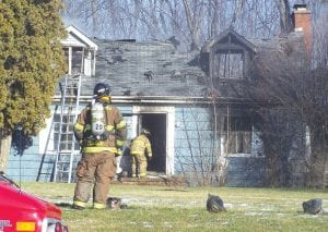 ROAD CLOSED — Miller Road in Swartz Creek was closed for several hours Jan. 16 while Swartz Creek and Flint Township fire fighters worked to extinguish a fire at a residence in the 8200 block of Miller Road.
