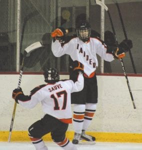 Flushing/Carman-Ainsworth's Trevor Sauve celebrates with an unidentifiable teammate