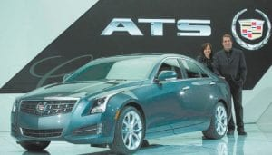 Standing with the Cadillac ATS are General Motors vice president for global product development Mary Barra, left, and GM North America President Mark Reuss. (General Motors)