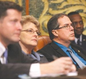 State Rep. Charles Smiley (D-Burton) listens during the State of the State address Jan. 16, at the state Capitol. Seated to Smiley's right is state Rep. Pamela Faris (D-Clio).