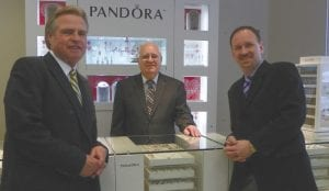 Michael Goulet, manager, (left to right) Bob Gaines, founder, and David Gaines, president of Gaines Jewelry Inc. prepare to make a video acknowledging 50 years in business.