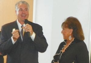 Larry White, co-owner of The Patsy Lou Automotive Group, with Patsy Lou Williamson at an event last year.