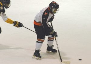 Flushing/Carman-Ainsworth's Jeff Fisher looks at his options with the puck.