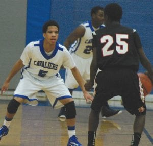 Carman-Ainsworth's Justin Person turns up the defensive pressure.
