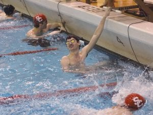 Tyler Arnold checks the board for his time during a meet in December.