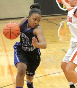 Carman-Ainsworth's Bianca Jackson drives past a defender in a game Jan. 25.