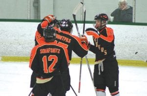 The Flushing hockey team celebrates a goal during an early season match up with Goodrich at the Polar Palace in Lapeer.