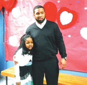 Montrell Givens and daughter Nyla Givens, 6, at the Daddy/Daughter, Mother/Son dance held at Rankin Elementary school last Friday night for students at Randels and Dye elementaries. A second dance followed on Saturday night for students at Rankin and Dillon elementaries.
