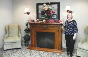 Lorry Burley, adminstrator at Kith Haven nursing home, shows off the lobby decorated to offer a cozy