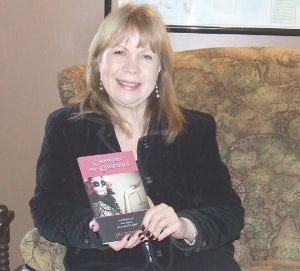 "Author Jill Stodola shows off her debut book, ""Cadavers and Cocktails,"" which she calls ""A collection of stories from dark to light."""