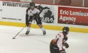 Flushing's Trevor Sauve looks to move the puck up ice on Jan. 12 against Goodrich.