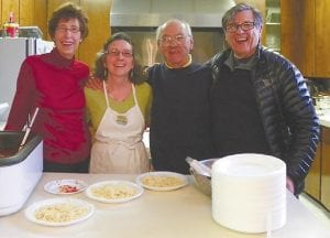 Doyle Rice, founder of the In-Between Cafe with Mary McClellan, Rita McCarthy and Fred McClellan — church members who volunteer every week to cook free Sunday dinners for students who come to the youth center.