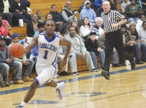 Carman-Ainsworth's Denzel Watts drives hard for an uncontested layup.