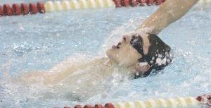 Carman-Ainsworth's Tyler Pangerl swims the backstroke.