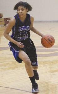 Aliah Stinnett drives the ball upcourt in last week's district tournament.