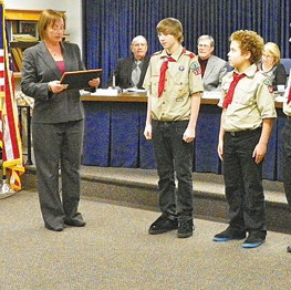 Supervisor Karyn Miller presents certificate of achievement to Troop No. 316 for cleaning up the township park.