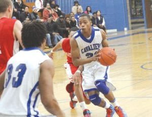Jaylen Randle dribbles the ball for Carman-Ainisworth.