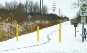 TRAILBLAZER — The Genesee Valley Trail does not officially open for the season for two more weeks but not even a twoinch snowfall last Friday night was enough to discourage early-morning bikers from riding the snow-covered route.