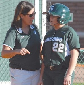 MSU softball coach and Carman-Ainsworth grad Jacquie Joseph talks with a player at the plate.