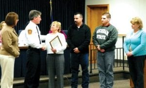 Supervisor Karyn Miller and Fire Chief John Ringwelski present a proclamation to the family of the late Randolph Rice in recognition of his 42 years of service to the township.