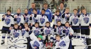 The 02 Lapeer Storm posed with their tournament trophy.