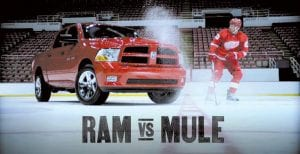 "Detroit Red Wings forward Johan ""Mule"" Franzen is pictured with the Dodge Ram 1500 Express 4x4 Crew Cab, the ""Official Truck of the Red WIngs""."