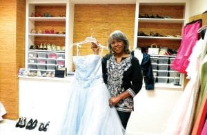 Walethia Aquil, founder of My Dreams Do Come True, shows one of more than 300 prom dresses being offered to young women countywide.