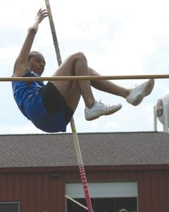 Carman-Ainsworth's Diamond Scales attempts to clear the bar in the pole vault at Davison during the 2011-12 season.