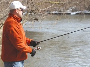 Flint Township's Martin Gunther casts a line for walleye during the annual Flushing Walleye Festival on March 9.