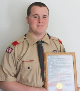 Tyler Duso holds his proclamation from Mayor David Krueger. He received the proclamation upon earning his Eagle Scout rank.
