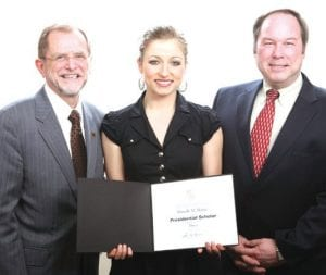 Danielle M. Mattar receives her 2013 Presidential Scholar certificate from (left to right) Dr. John M. Dunn, WMU president, and Dr. William G. Rantz, WMU Faculty Senate president.