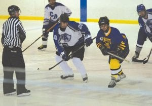 Carman-Ainsworth takes on Flint Southwestern in a 2011 alumni hockey tournament at Ice Mountain Arena.