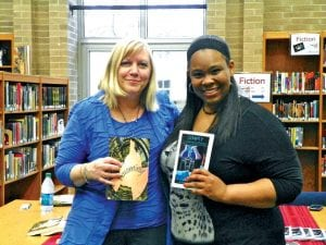 Susan Sage and Jessyca Matthews, staff at CAHS, with copies of their books presented at book signing event.