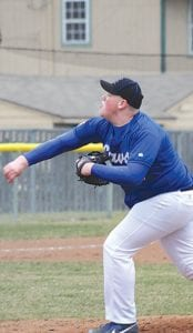 Carman-Ainsworth's Justin Hubbard pitches for the Cavaliers against Bendle on April 17.