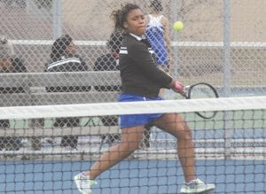 Carman-Ainsworth's Cionna Orr belts a two-handed backhand.