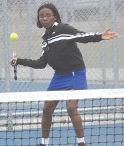 Carman-Ainsworth's J'lynn Corder waits for just the right moment to return a forehand against Lapeer West.
