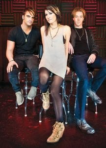 Sick Puppies are returning to the Machine Shop May 17. The trio (left to right) drummer Mark Goodwin, bassist Emma Anzai and vocalist/guitarist/ songwriter Shimon Moore will release their new single