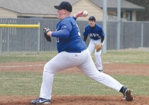 Carman-Ainsworth's Justin Hubbard delivers a pitch home against Bendle.