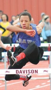 Andre Thornton clears a hurdle in a meet April 12 at Davison.