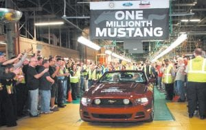 Employees at Ford's Flat Rock Assembly Plant cheer as the plant's one- millionth Mustang rolls off the line.