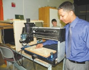 The event included a look inside C-A's new Design and Build classroom where aspiring engineers like Shaquelle Polacek, a senior, have spent the school year learning to create computer-assisted woodcarving projects.