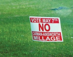 School and township officials don't know who was responsible for anti-millage signs like this one that began cropping up about a week before the election.