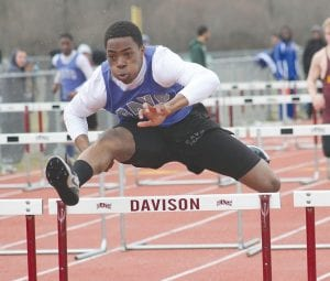 Bryant Hudson competes in the hurdles for the Carman-Ainsworth varsity track team.