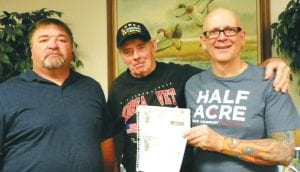 Korean War Vet Fred Feltner (center) with 2011 and 2012 tax refund checks obtained with the help of (left to right) Byron Crumley, tax preparer, and Bill Tadrick, president of Tadrick Tax Service on Bristol Road.