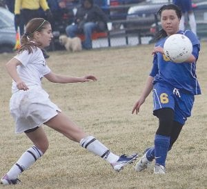 Carman-Ainsworth's Melody Bamford (left) battled against Kearsley during the regular season on April 8.